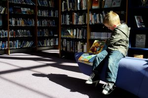 child sitting in the library
