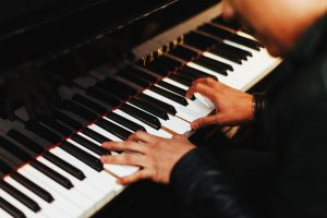 A man playing a piano.