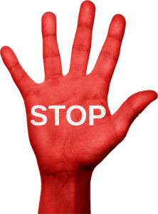"A red hand with ""stop"" word written on it"