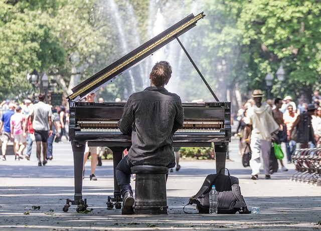 A man playing a piano in the park.