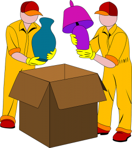 Movers packing items in a box
