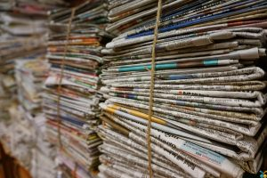 Old newspapers used to pack fragiles for nationwide relocation