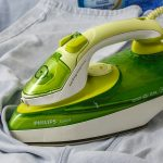 Steam iron on the clothes.