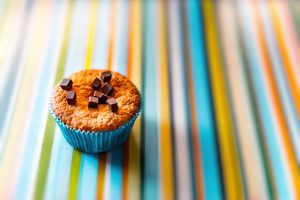 A muffin on a colorful surface