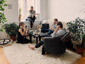 A group of friends sitting in a living room
