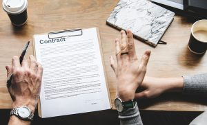 Two people speaking over a contract