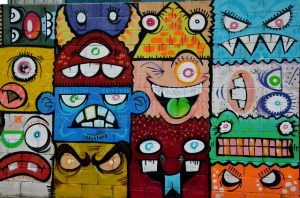 Graffiti of little monsters on the wall