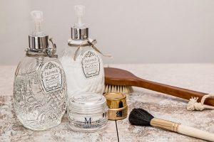 Two bottles of perfume, brush, pomade