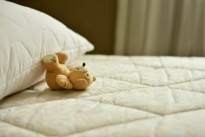 Mattress, pillow and a teddy bear