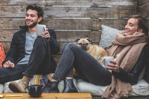 Man and woman and a pug sitting and chilling