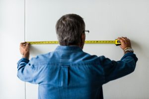 Man measuring