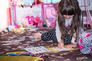 Little girl playing in her room.