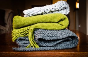 A pile of old blankets. Blankets are another type of reusable packing supplies.