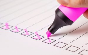 checklist and pink marker