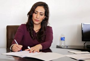 a woman doing paperwork