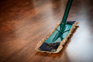 cleaning the floor - sweep the floors to clean your NYC home