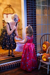 a girl doing trick or treat