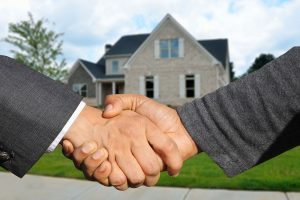 a handshake after home purchasing