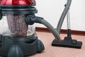 vacuum cleaner on rugs - the vacuum is necessary if you want to clean your NYC home