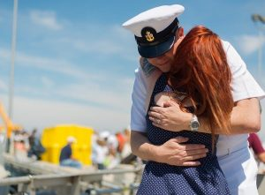 Army man and his wife hugging