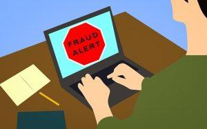 Fraud alert sing on a laptop