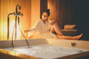 girl sitting near the hot tub