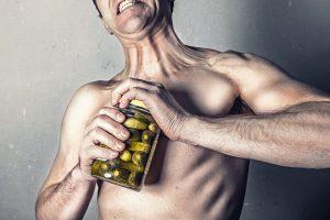 Man oppening a jar