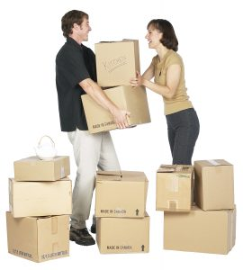 A man and a woman holding their moving boxes