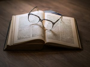 A book and glasses