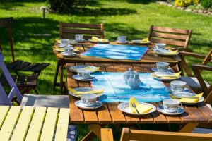 A table with cups in the garden