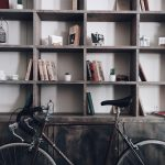 A shelf with things and a bicycle