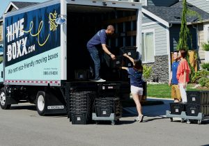 People unloading stuff from the moving truck