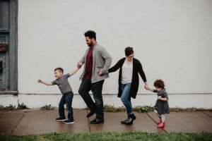 family walking in the street to keep your kids entertained during the move