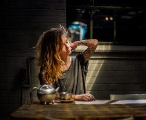 A girl drinks tea