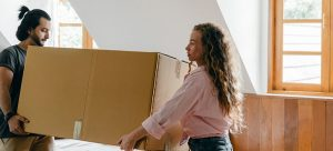 couple decluttering their attic before moving