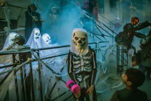 kid dressed up as skeleton