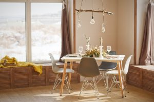 white table with brown chairs