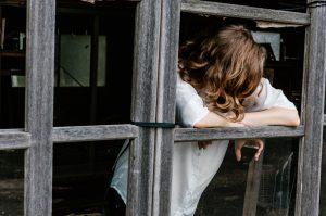 A sad girl at the window