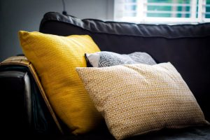 spruce up your rental in Manhattan with colorful pillows