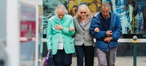three seniors walking through town