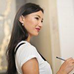 A woman holding a checklist