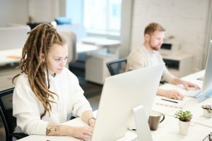 two people in the office, working