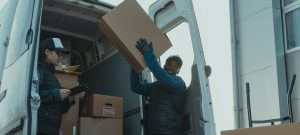A man unloading the moving truck