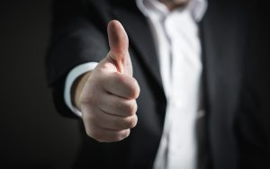 person in a suit, thumbs up