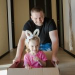A father and daughter relocating - include your kids in the unpacking process with the help of our guide
