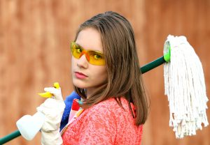 a woman with cleaning supplies
