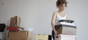 Picture of a woman carrying boxes