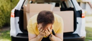 man stressed about moving