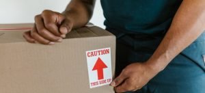 Picture of a moving professional. The easiest way to organize a short notice move from NYC is to call professional packers