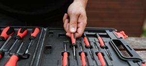 Person choosing a screwdriver